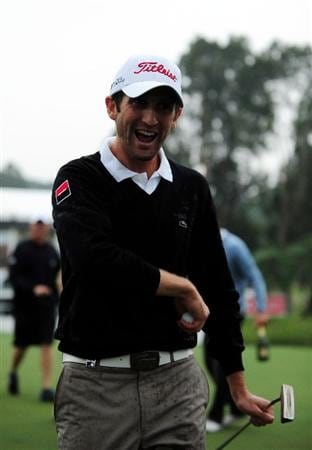 HONG KONG - NOVEMBER 15:  Gregory Bourdy of France celebrates winning the UBS Hong Kong Open at the Hong Kong Golf Club on November 15, 2009 in Fanling, Hong Kong.  (Photo by Stuart Franklin/Getty Images)