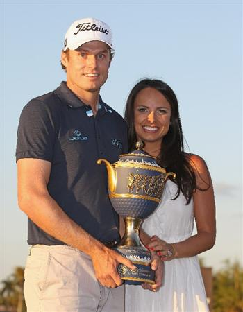 DORAL, FL - MARCH 13:  Nick Watney poses with his wife Amber and the Gene Sarazen trophy after his two-stroke victory at the 2011 WGC- Cadillac Championship at the TPC Blue Monster at the Doral Golf Resort and Spa on March 13, 2011 in Doral, Florida.  (Photo by Sam Greenwood/Getty Images)