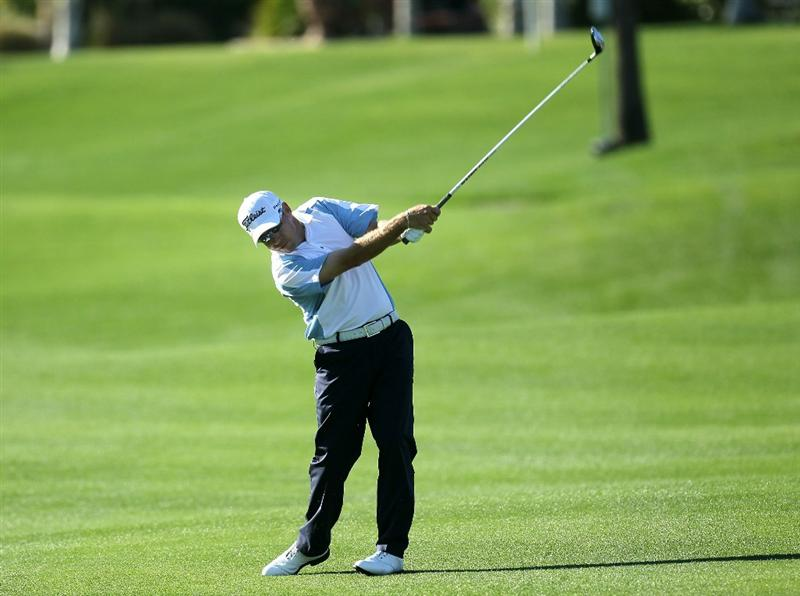 LA QUINTA, CA - JANUARY 19:  Brian Davis of England hits his second shot on the second hole during round one of the Bob Hope Classic at the Palmer Private Course at PGA West on January 19, 2011 in La Quinta, California.  (Photo by Stephen Dunn/Getty Images)