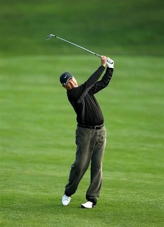 SAN FRANCISCO - NOVEMBER 07:  John Cook hits his second shot on the 15th hole during the final round of the Charles Schwab Cup Championship at Harding Park Golf Course on November 7, 2010 in San Francisco, California.  (Photo by Ezra Shaw/Getty Images)