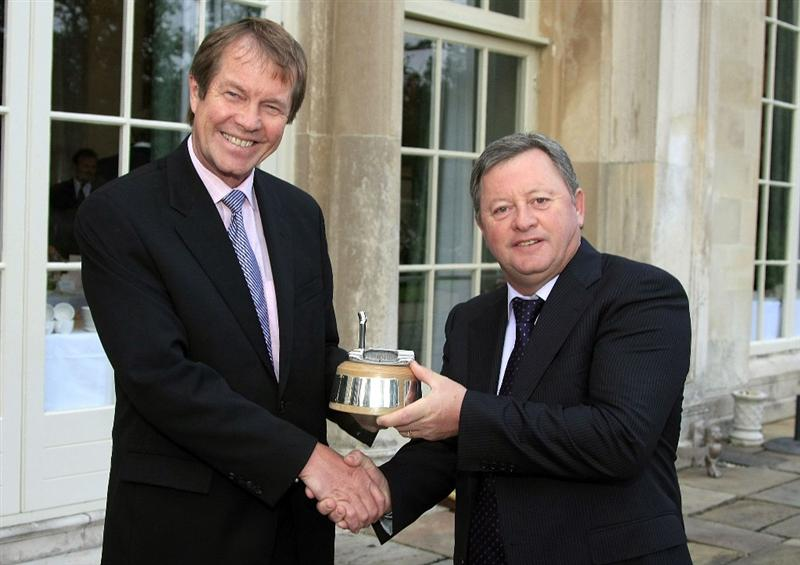 WOBURN, ENGLAND - SEPTEMBER 04:  Ian Woosnam of Wales receives from George O'Grady, Chief Executive of the European Tour, the Rookie of the Year Award at the Annual Awards Dinner held at Woburn Abbey prior to the first round of the Travis Perkins plc Senior Masters played at The Duke's Course, Woburn Golf Club on September 3, 2009 in Woburn, United Kingdom  (Photo by Phil Inglis/Getty Images)