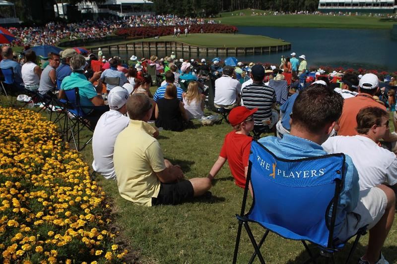 PONTE VEDRA BEACH, FL - MAY 15:  Fans watch the play on the 17th hole during the final round of THE PLAYERS Championship held at THE PLAYERS Stadium course at TPC Sawgrass on May 15, 2011 in Ponte Vedra Beach, Florida.  (Photo by Scott Halleran/Getty Images)