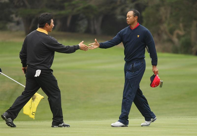 SAN FRANCISCO - OCTOBER 11:  Tiger Woods of the USA Team shakes hands with Y. E. Yang of the International Team after winning the Singles Match and The Presidents Cup at Harding Park Golf Course on October 11, 2009 in San Francisco, California.  (Photo by Warren Little/Getty Images)