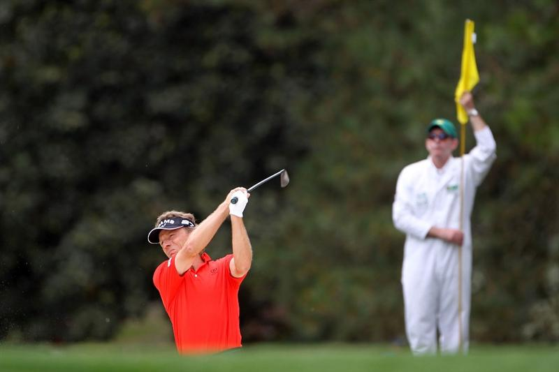 AUGUSTA, GA - APRIL 08:  Bernhard Langer of Germany (L) plays a shot on the tenth hole while caddie Terry Holt looks on during the first round of the 2010 Masters Tournament at Augusta National Golf Club on April 8, 2010 in Augusta, Georgia.  (Photo by Jamie Squire/Getty Images)
