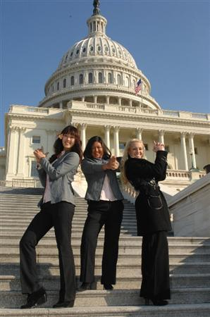 WASHINGTON - JANUARY 12:  (L-R) Michelle Wie, Christina Kim and Natalie Gulbis of the 2009 United States Solheim Team poses for photo in front the Capital during visit to celebrate team win in Solheim Cup January 12, 2010 in Washington, DC.  (Photo by Mitchell Layton/Getty Images)
