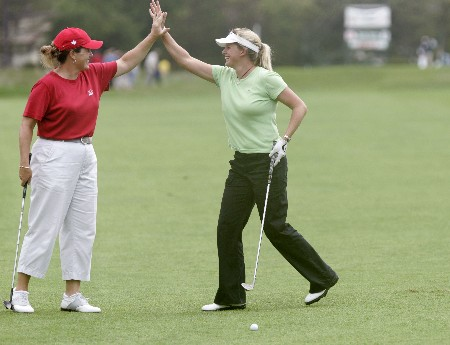 Lorie Kane congratulating Johanna Head after she hit an eagle during the second round of the 2005 ShopRite LPGA Classic at the Seaview Resort & Spa in Galloway Township, New Jersey on June 3, 2005.Photo by Scott Clarke/WireImage.com