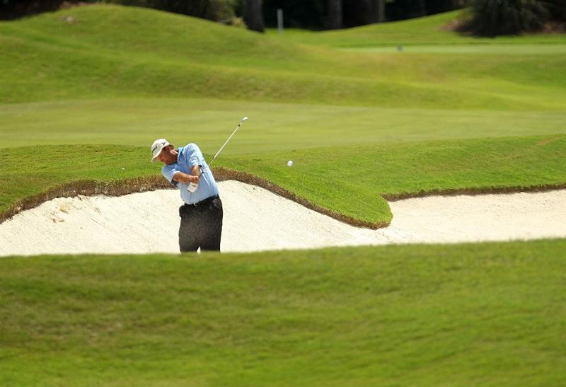 CORRECTED VERSION: LUTZ, FL - APRIL 15: Brad Bryant hits out of the fairway bunker on the 15th hole during the first round of the Outback Steakhouse Pro-Am at the TPC of Tampa on April 15, 2011 in Lutz, Florida.  (Photo by Mike Ehrmann/Getty Images)
