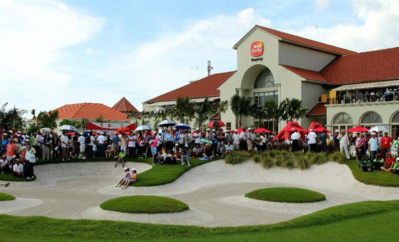 KUALA LUMPUR, MALAYSIA - OCTOBER 24 : The crowd on the 18th green adjacent to the Club House during the Final Round of the Sime Darby LPGA on October 24, 2010 at the Kuala Lumpur Golf and Country Club in Kuala Lumpur, Malaysia. (Photo by Stanley Chou/Getty Images)