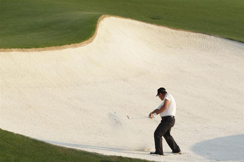 AUGUSTA, GA - APRIL 10:  K.J. Choi of South Korea plays a bunker shot on the 18th hole during the final round of the 2011 Masters Tournament on April 10, 2011 in Augusta, Georgia.  (Photo by David Cannon/Getty Images)