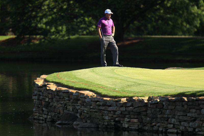 CHARLOTTE, NC - MAY 05:  Phil Mickelson waits to putt on the 17th hole during the first round of the Wells Fargo Championship at Quail Hollow Club on May 5, 2011 in Charlotte, North Carolina.  (Photo by Streeter Lecka/Getty Images)