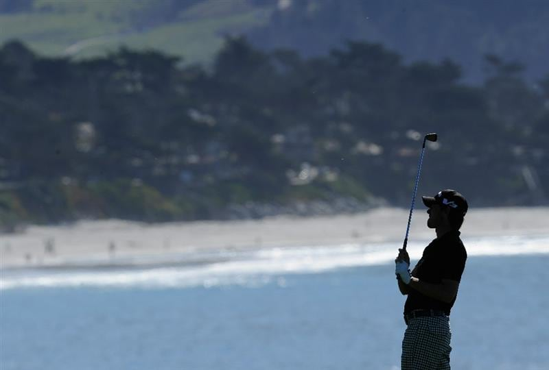 PEBBLE BEACH, CA - FEBRUARY 11:  Aaron Baddeley of Australia plays his approach shot on the eighth hole during the second round of the AT&T Pebble Beach National Pro-Am at the Pebble Beach Golf Links on February 11, 2011  in Pebble Beach, California  (Photo by Stuart Franklin/Getty Images)