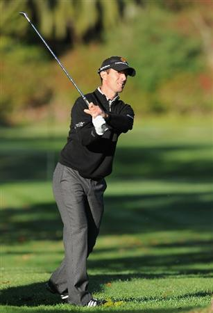 PACIFIC PALISADES, CA - FEBRUARY 17:  Mike Weir of Canada plays his approach shot on the first hole during the first round of the Northern Trust Open at Riviera Country Club on February 17, 2011 in Pacific Palisades, California.  (Photo by Stuart Franklin/Getty Images)