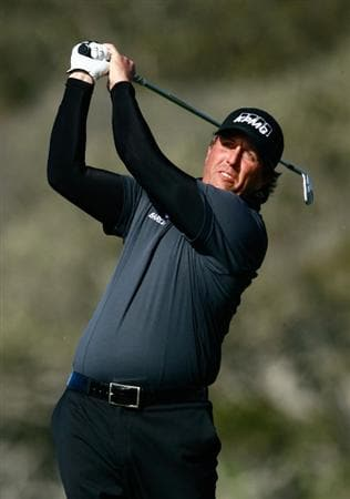 PEBBLE BEACH, CA - FEBRUARY 14: Phil Mickelson hits a tee shot on the fifth hole during the third round of the AT&T Pebble Beach National Pro-Am at the Pebble Beach Golf Links on February 14, 2009 in Pebble Beach, California. (Photo by Jeff Gross/Getty Images)