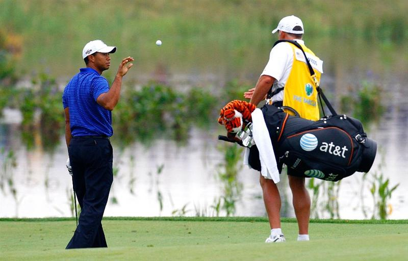 JERSEY CITY, NJ - AUGUST 29:  Caddie Steve Williams of New Zealand (R) tosses a new ball to Tiger Woods after his second shot landed in the water on the 13th hole during round three of The Barclays on August 29, 2009 at Liberty National in Jersey City, New Jersey.  (Photo by Kevin C. Cox/Getty Images)
