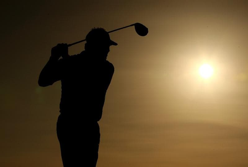 VILAMOURA, PORTUGAL - OCTOBER 16:  Darren Clarke of Northern Ireland tee's off into the setting sun at the 18th during the first round of the Portugal Masters at the Oceanico Victoria Golf Course on October 16, 2008 in Vilamoura, Portugal.  (Photo by Richard Heathcote/Getty Images)