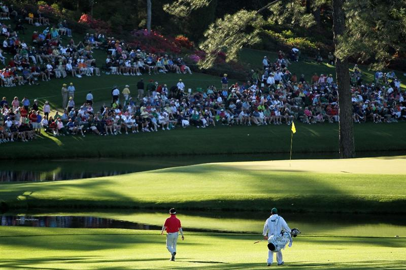 AUGUSTA, GA - APRIL 09:  Y.E. Yang of South Korea walks to the 15th green with his caddie A.J. Montecinos during the second round of the 2010 Masters Tournament at Augusta National Golf Club on April 9, 2010 in Augusta, Georgia.  (Photo by Jamie Squire/Getty Images)