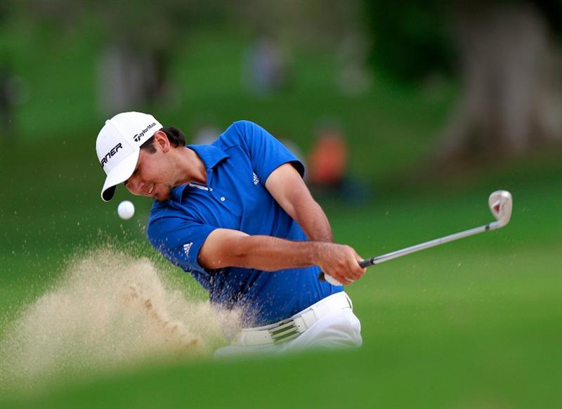 HONOLULU, HI - JANUARY 16:  Jason Day of Australia plays a shot on the 5th hole during the final round of the Sony Open at Waialae Country Club on January 16, 2011 in Honolulu, Hawaii.  (Photo by Sam Greenwood/Getty Images)