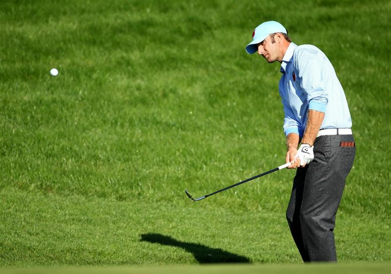 NEWPORT, WALES - SEPTEMBER 28:  Dustin Johnson of the USA hits a pitch shot during a practice round prior to the 2010 Ryder Cup at the Celtic Manor Resort on September 28, 2010 in Newport, Wales.  (Photo by Andy Lyons/Getty Images)