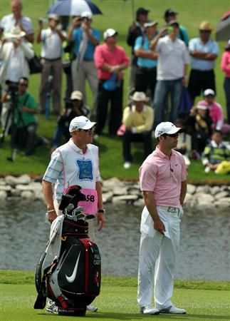 CHONBURI, THAILAND - NOVEMBER 08: Paul Casey of England and his caddie waits for his turn to play on the 2nd hole during the World Golf Salutes King Bhumibol Skins tournament at Amata Spring Country Club on November 8, 2010 in Bangkok, Thailand. (Photo by Stanley Chou/Getty Images)