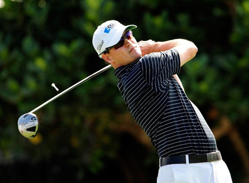 KAPALUA, HI - JANUARY 08:  Zach Johnson hits a shot on the 1st hole during the second round of the SBS Championship at the Plantation course on January 8, 2010 in Kapalua, Maui, Hawaii.  (Photo by Sam Greenwood/Getty Images)