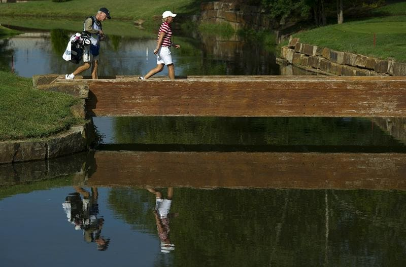 ROGERS, AR - SEPTEMBER 11:  Becky Morgan of Wales walks across the bridge from the sixth green to the seventh tee box with her caddie during the second round of the P&G NW Arkansas Championship at the Pinnacle Country Club on September 11, 2010 in Rogers, Arkansas.  (Photo by Robert Laberge/Getty Images)