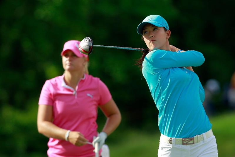 GLADSTONE, NJ - MAY 20:  Michelle Wie (R) hits her tee shot on the first playoff hole against  Anna Nordqvist (L) of Sweden in round two of the Sybase Match Play Championship at Hamilton Farm Golf Club on May 20, 2011 in Gladstone, New Jersey. (Photo by Chris Trotman/Getty Images)