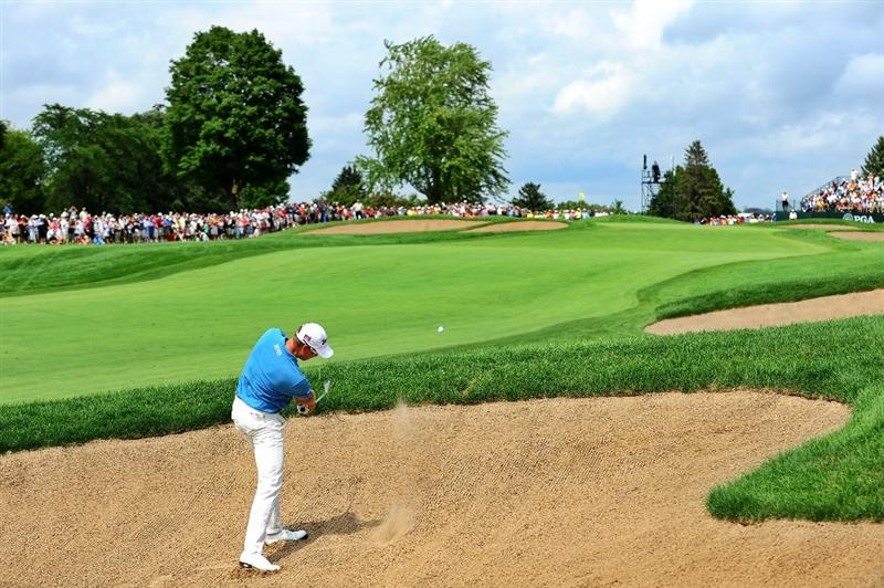 CHASKA, MN - AUGUST 16:  Henrik Stenson of Sweden hits a bunker shot on the second hole during the final round of the 91st PGA Championship at Hazeltine National Golf Club on August 16, 2009 in Chaska, Minnesota.  (Photo by Stuart Franklin/Getty Images)