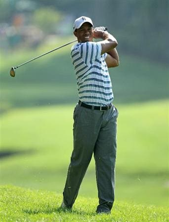 DUBLIN, OH - JUNE 04:  Tiger Woods hits his second shot on the 15th hole during the second round of The Memorial Tournament presented by Morgan Stanley at Muirfield Village Golf Club on June 4, 2010 in Dublin, Ohio.  (Photo by Andy Lyons/Getty Images)