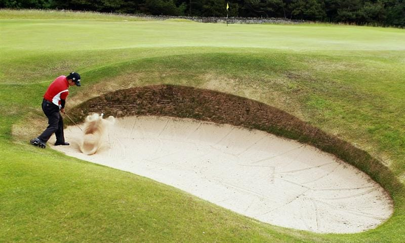 GULLANE, SCOTLAND - JUNE 18:  Jin Jeong of Korea plays out of the fifth greenside bunker during his Quarter Final match against Paul Cutler of Northern Ireland for The Amateur Championship at Muirfield Golf Club on June 18, 2010 in Gullane, Scotland.  (Photo by Warren Little/Getty Images)
