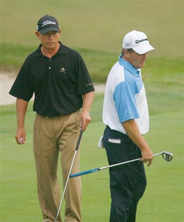 CONOVER, NC - SEPTEMBER 18:  Mike Goodes (L) and Fred Funk wait on the 18th green, Funk was assessed a penalty for using one of Goodes clubs earlier during the first round of the Greater Hickory Classic at the Rock Barn Golf & Spa on September 18, 2009 in Conover, North Carolina.  (Photo by Scott Halleran/Getty Images)