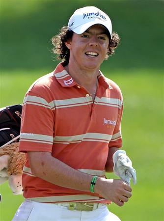 ABU DHABI, UNITED ARAB EMIRATES - JANUARY 23:  Rory McIlroy of Northern Ireland smiles on the fifth hole during the third round of The Abu Dhabi Golf Championship at Abu Dhabi Golf Club on January 23, 2010 in Abu Dhabi, United Arab Emirates.  (Photo by Andrew Redington/Getty Images)