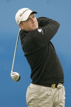 Graeme Storm watches his tee shot during the rain delayed second round of the 2005 Deutsche Bank Players Championship at Gut Kaden Golf Club in Hamburg, Germany on July 23, 2005.Photo by Pete Fontaine/WireImage.com