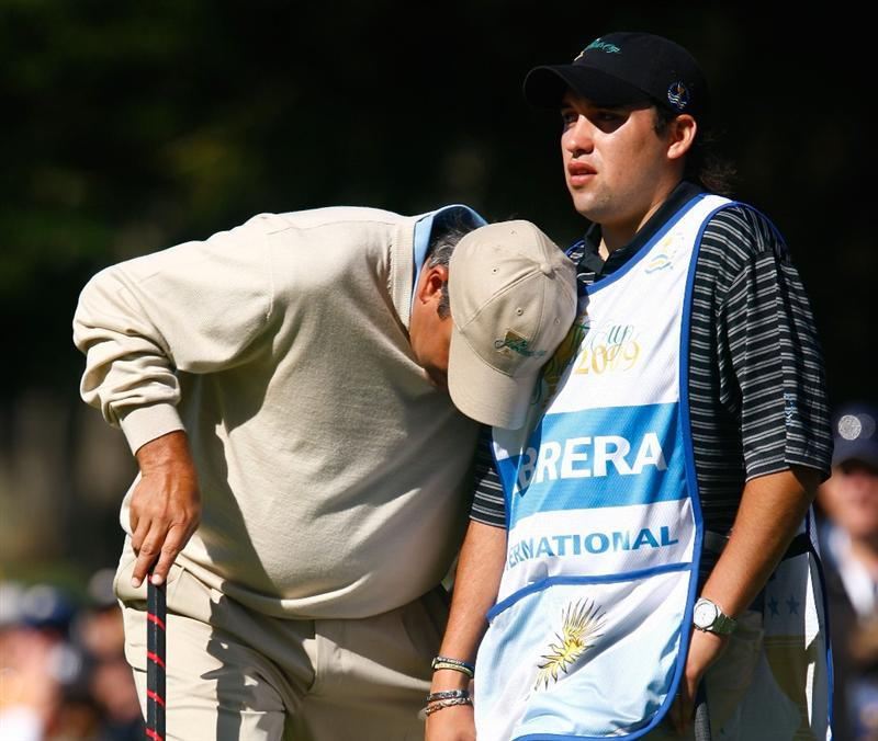 SAN FRANCISCO - OCTOBER 09:  Angel Cabrera of the International Team reacts to a missed putt on the eighth green alongside his son Angel Jr. during the Day Two Fourball Matches of The Presidents Cup at Harding Park Golf Course on October 9, 2009 in San Francisco, California.  (Photo by Scott Halleran/Getty Images)