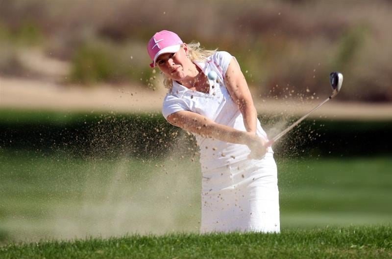 DUBAI, UNITED ARAB EMIRATES - DECEMBER 12:  Nina Reis of Sweden hits her second shot at the 9th hole during the second round of the Dubai Ladies Masters on the Majilis Course at the Emirates Golf Club on December 12, 2008 in Dubai,United Arab Emirates  (Photo by David Cannon/Getty Images)