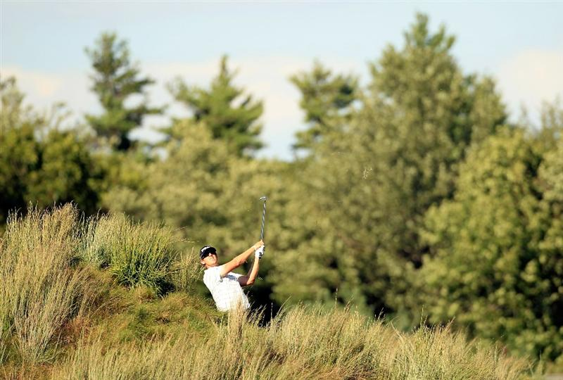 NORTON, MA - SEPTEMBER 04:  Hunter Mahan hits his second shot on the 14th hole in the second round of the Deutsche Bank Championship at TPC Boston on September 4, 2010 in Norton, Massachusetts.  (Photo by Michael Cohen/Getty Images)