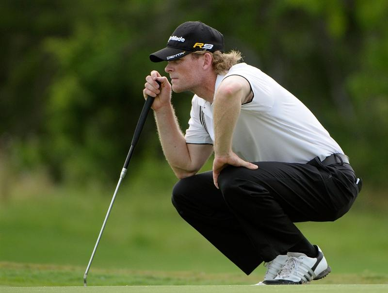 SAN ANTONIO, TX - MAY 15:  James Driscoll lines up a putt for birdie on the par three 7th hole  during the second round of the Valero Texas Open at the TPC San Antonio on May 15, 2010 in San Antonio, Texas. (Photo by Marc Feldman/Getty Images)