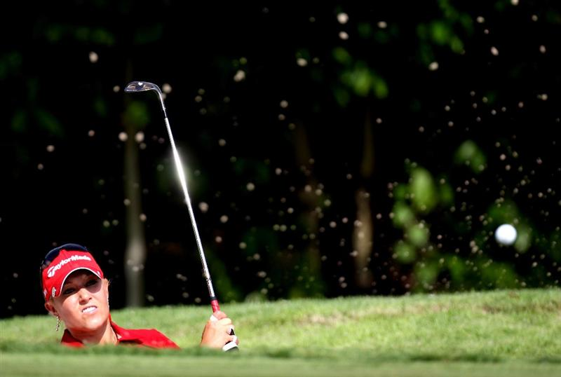 SINGAPORE - MARCH 06:  Natalie Gulbis of the USA plays her third shot on the par four 4th hole during the second round of HSBC Women's Champions at the Tanah Merah Country Club on March 6, 2009 in Singapore.  (Photo by Ross Kinnaird/Getty Images)