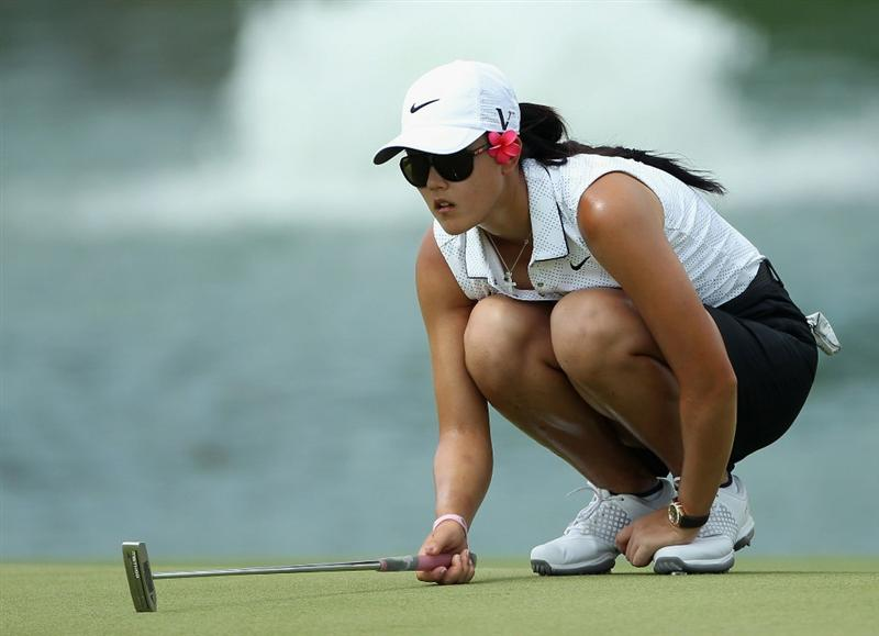SINGAPORE - FEBRUARY 24:  Michelle Wie of the USA lines up a putt on the 18th hole during the first round of the HSBC Women's Champions at the Tanah Merah Country Club on February 24, 2011 in Singapore.  (Photo by Andrew Redington/Getty Images)