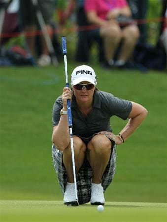 KUALA LUMPUR, MALAYSIA - OCTOBER 24 : Maria Hjorth of Sweden lines up for a putt on the 3rd hole during the Final Round of the Sime Darby LPGA on October 24, 2010 at the Kuala Lumpur Golf and Country Club in Kuala Lumpur, Malaysia. (Photo by Stanley Chou/Getty Images)
