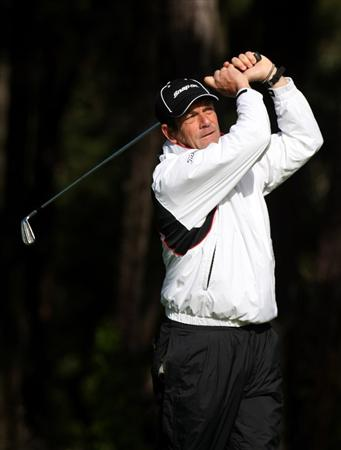 PEBBLE BEACH, CA - FEBRUARY 13: Singer Huey Lewis hits his tee shot on the 11th hole at Poppy Hills Golf Course during the second round of the the AT&T Pebble Beach National Pro-Am on February 13, 2009 in Pebble Beach, California. (Photo by Stephen Dunn/Getty Images)