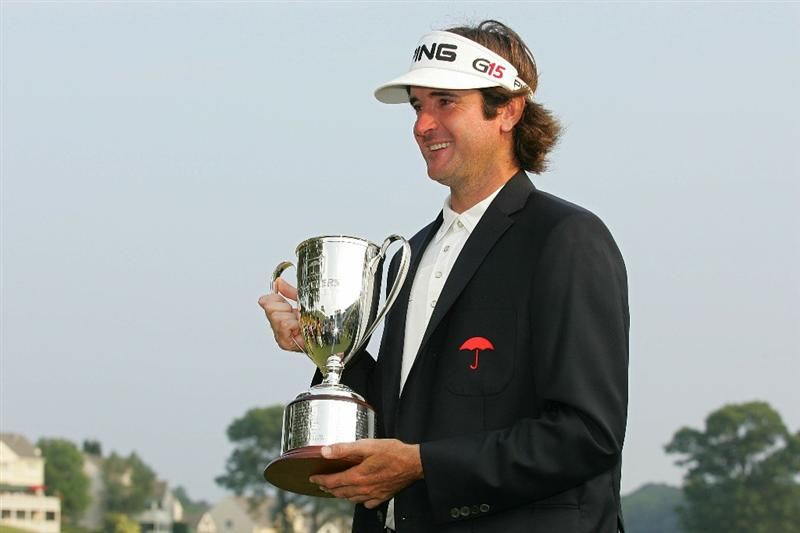 CROMWELL, CT - JUNE 27:  Bubba Watson holds the trophy after winning a three-way two-hole playoff after the final round of the Travelers Championship held at TPC River Highlands on June 27, 2010 in Cromwell, Connecticut.  (Photo by Michael Cohen/Getty Images)