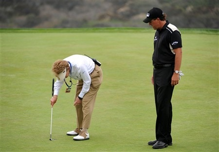 SAN DIEGO - JUNE 14:  A USGA official confers with Phil Mickelson on the third green during the third round of the 108th U.S. Open at the Torrey Pines Golf Course (South Course) on June 14, 2008 in San Diego, California.  (Photo by Harry How/Getty Images)