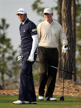 ICHEON, SOUTH KOREA - APRIL 29:  Dustin Johnson of the USA (left) watches his tee-shot on the 11th hole as Ernie Els of South Africa (right) looks on during the second round of the Ballantine's Championship at Blackstone Golf Club on April 29, 2011 in Icheon, South Korea.  (Photo by Andrew Redington/Getty Images)