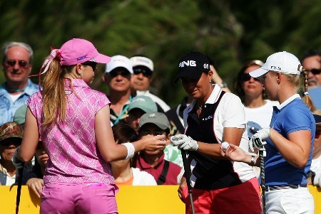 KAHUKU, HI - FEBRUARY 17:  Paula Creamer compares golf balls with Sherri Steinhauer and Morgan Pressel on the first hole during the final round of the SBS Open, the first event of the 2007 LPGA season at the Turtle Bay Resort Arnold Palmer Course February 17, 2007 in Kahuku, Hawaii.  (Photo by Harry How/Getty Images)