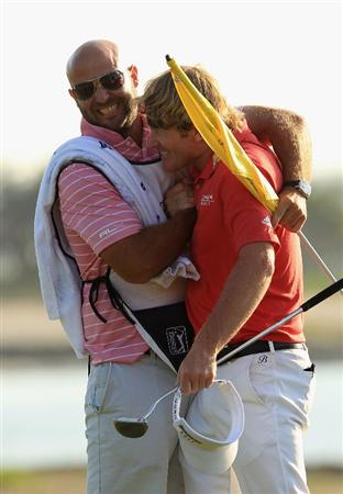 HILTON HEAD ISLAND, SC - APRIL 24:  Brandt Snedeker celebrates with caddie Scott Vail after defeating Luke Donald in a playoff during the final round of The Heritage at Harbour Town Golf Links on April 24, 2011 in Hilton Head Island, South Carolina.  (Photo by Streeter Lecka/Getty Images)