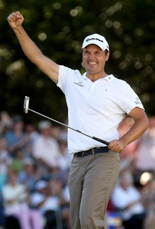 VIRGINIA WATER, ENGLAND - MAY 23:  Simon Khan of England celebrates holing a birdie putt on the 18th green during the final round of the BMW PGA Championship on the West Course at Wentworth on May 23, 2010 in Virginia Water, England.  (Photo by Andrew Redington/Getty Images)