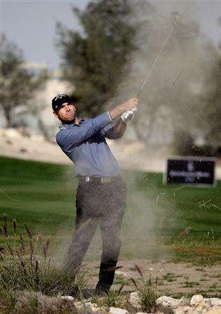 DOHA, QATAR - JANUARY 29:  Oliver Wilson of England on the par four 15th hole during the second round of the Commercialbank Qatar Masters at the Doha Golf Club on January 29, 2010 in Doha, Qatar.  (Photo by Ross Kinnaird/Getty Images)