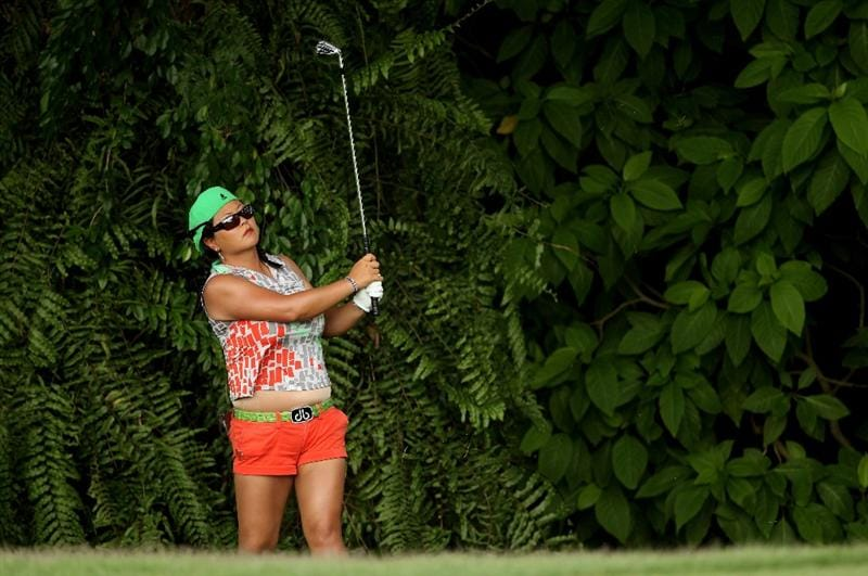SINGAPORE - FEBRUARY 25:  Christina Kim of the USA hits her third shot on the fifth hole during the first round of the HSBC Women's Champions at the Tanah Merah Country Club on February 25, 2010 in Singapore.  (Photo by Andrew Redington/Getty Images)