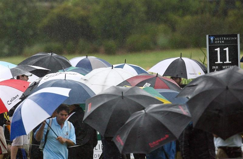 SYDNEY, AUSTRALIA - DECEMBER 12:  Spectators gather around the eleventh tee just before bad weather halted play during the second round of the 2008 Australian Open at The Royal Sydney Golf Club on December 12, 2008 in Sydney, Australia.