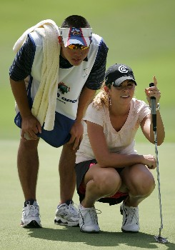 KAPOLEI, HI - FEBRUARY 21:  Erica Blasberg and her caddie line up a putt on the 9th hole during the first round of  the Fields Open on February 21, 2008  at the Ko Olina Golf Club in Kapolei, Hawaii.  (Photo by Andy Lyons/Getty Images)